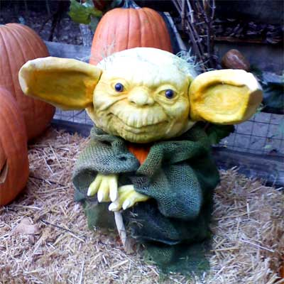 Yoda from Star Wars carved into a pumpkin