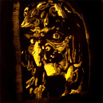 the evil hag from Snow White carved into a pumpkin