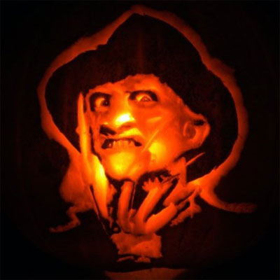 Freddy Krueger from Nightmare on Elm Street carved into a pumpkin