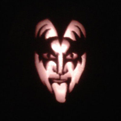 Gene Simmons in his Kiss makeup carved into a pumpkin