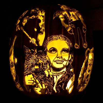 the characters from The Wizard of Oz carved into a pumpkin