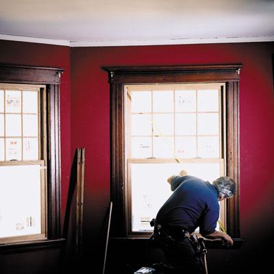man measuring replacement windows