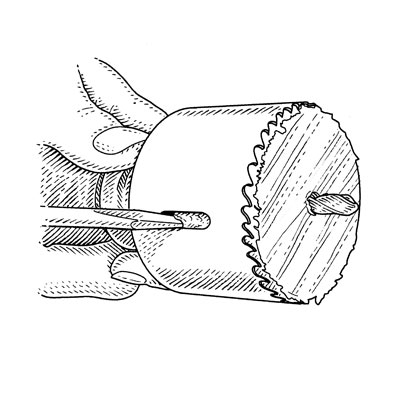 illustration of ejecting plug from hole saw