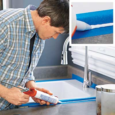 man shooting smooth caulk around kitchen sink