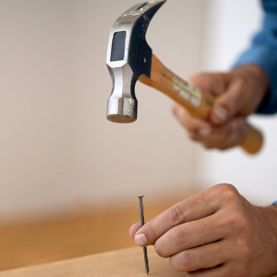 driving a nail with a hammer