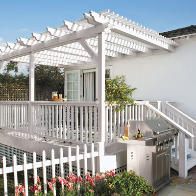 Backyard deck and patio of this bungalow after remodel