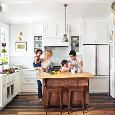 The Miller Pelaez family in their remodeled kitchen