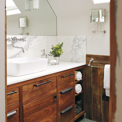 Miller Pelaez master bathroom after remodel with wood vanity, barn wood wainscoting