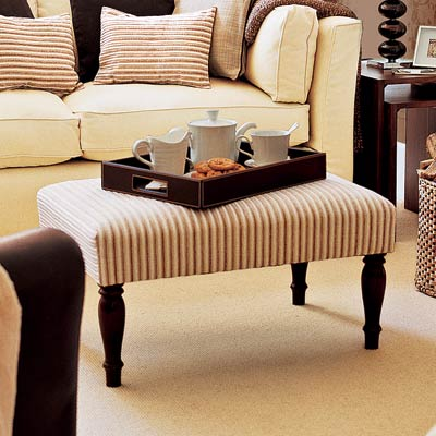 living room with upholstered ottoman