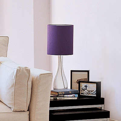 living room with streamlined table lamp