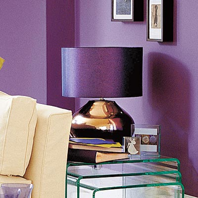 living room with metallic table lamp