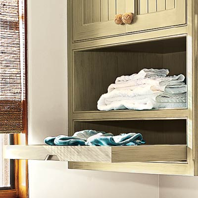 high efficiency laundry room with slide out drying racks