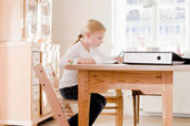 Girl doing homework at a desk table