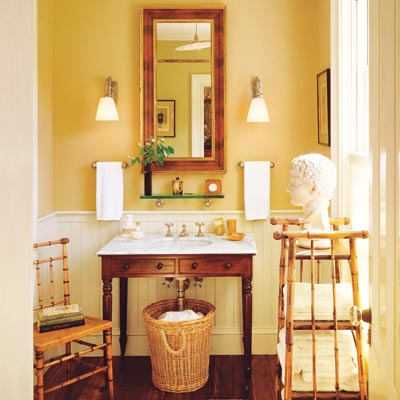 a half-bath furnished with Colonial details and wood accents