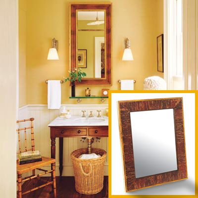 a half-bath furnished with Colonial details, mirror inset