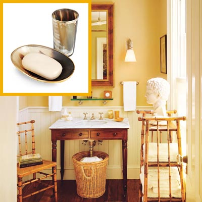 a half-bath furnished with Colonial details, metal soap dish and drinking tumbler inset