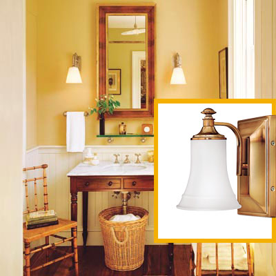 a half-bath furnished with Colonial details, bath sconce inset