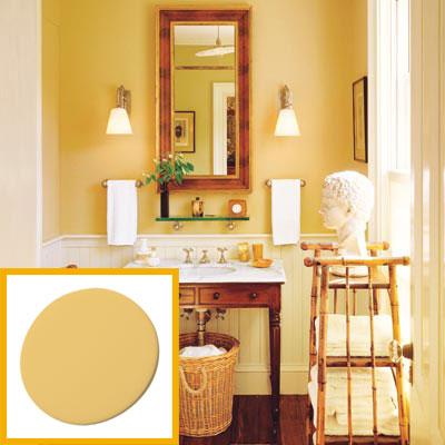a half-bath furnished with Colonial details, yellow-ochre paint drop inset