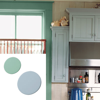 colorful cottage kitchen with blue cabinet and trim paint