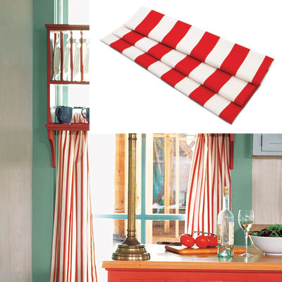colorful cottage kitchen with red and white striped curtains