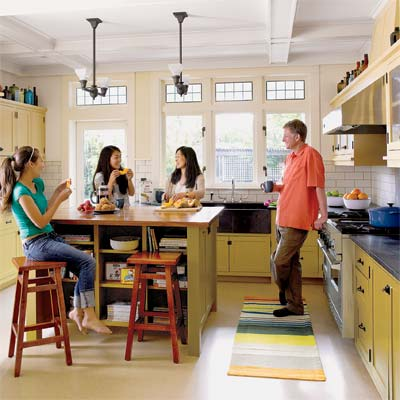 family gathered around the island in their newly remolded period look kitchen