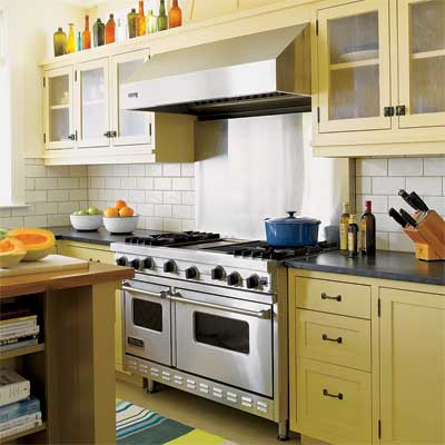 the existing range and hood were kept as part of this remodeled period look kitchen