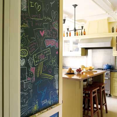 a magnetic chalkboard installed as part of this remodeled period look kitchen