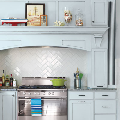 Kitchen with white-tile backsplash and light blue painted cabinets