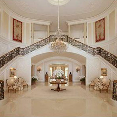 double staircase in foyer of candy spelling's LA home