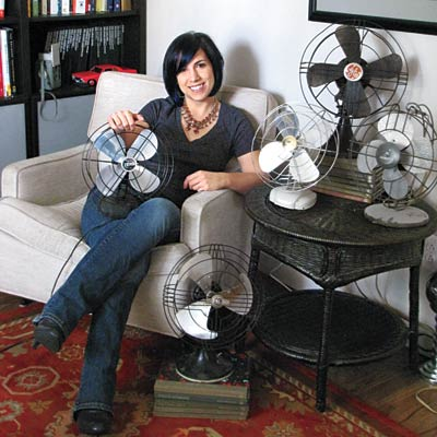 woman sitting with vintage fans