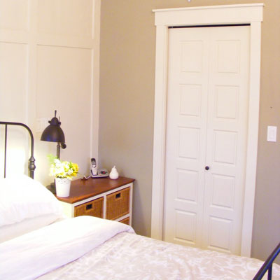 The Malinek's master bedroom with new paneled wall