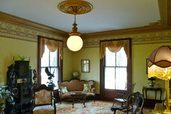 a family room remodeled in a Victorian parlor style