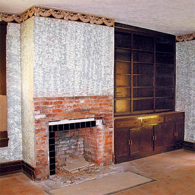 original brick fireplace flanked by built in bookshelves in this jefferson indiana house that needs saving