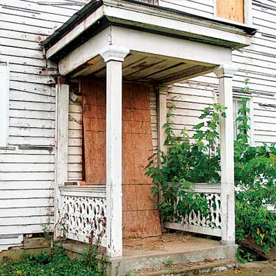side entry porch with original posts and hand-sawn railing in this jefferson indiana house that needs saving