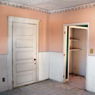 five-panel door  in this jefferson indiana house that needs saving