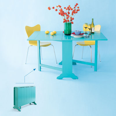 an aqua-blue drop-leaf dining table