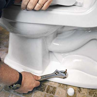 tighten closet bolts to steady a rocking toilet