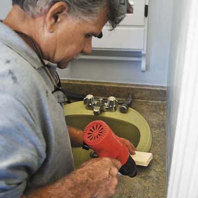 reattaching loose laminate countertop