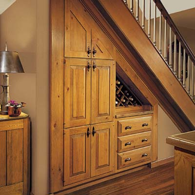 Stair wall wine cellar built in storage ideas this old for Under the stairs cabinet