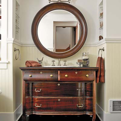 mahagony dresser in guest bathroom in remodeled houseboat