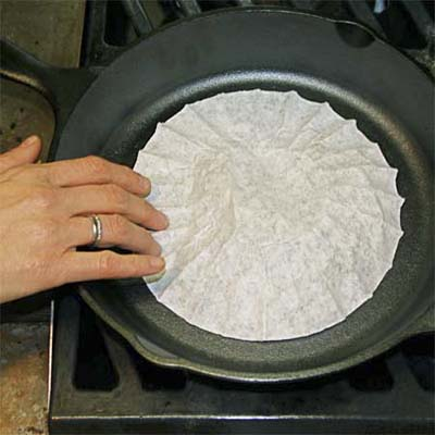 put a coffee filter in a cast-iron skillet