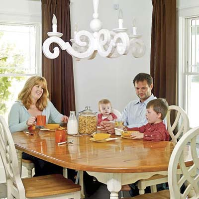 Homeowners Jennifer and Jeff Kuryluk with daughter and son at kitchen table