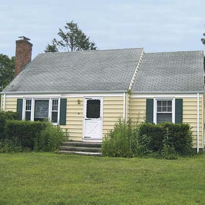 before exterior of Cape Cod remodel