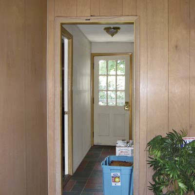 before photo of hallway leading to the garage in Cape Cod remodel