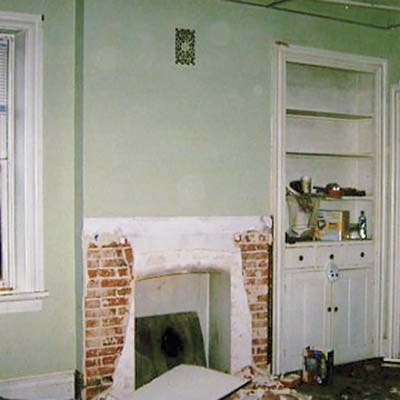 before photo of dining room with missing mantel
