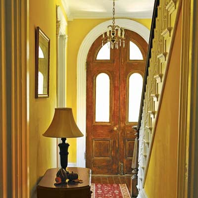 foyer with refinished entry doors and hardwood floors
