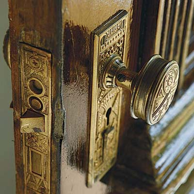 restored ornate cast-brass front door hardware