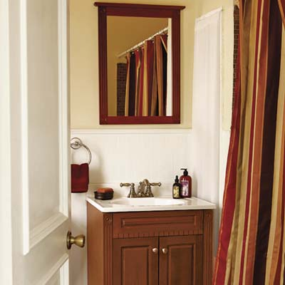 bath with wainscoting and cabinet sink and vanity with detailed moldings