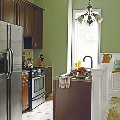 refinished kitchen with cherry cabinets, granite counters and stainless-steel appliances