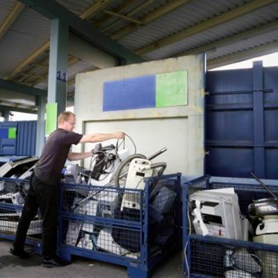 man recycling electronics